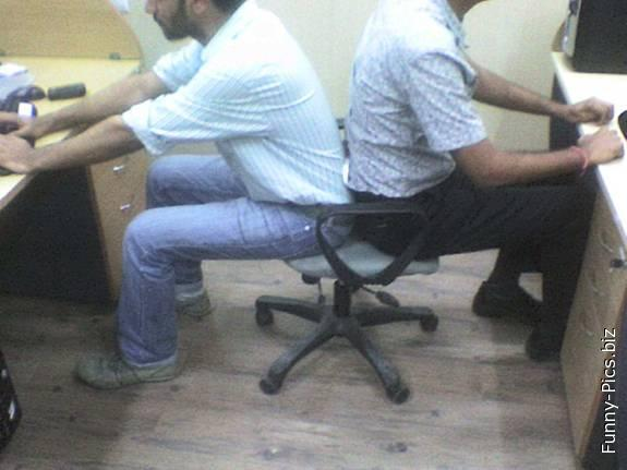 Coworkers sharing a seat